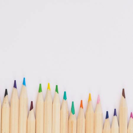colouring pencils in a row on a pale background